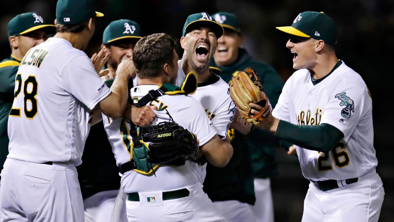The Oakland A's congratulating Mike Fiers after throwing his no-hitter on May 7.