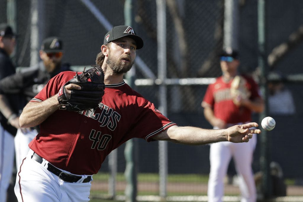 Pitcher Madison Bumgarner throws a pitch in Spring Training
