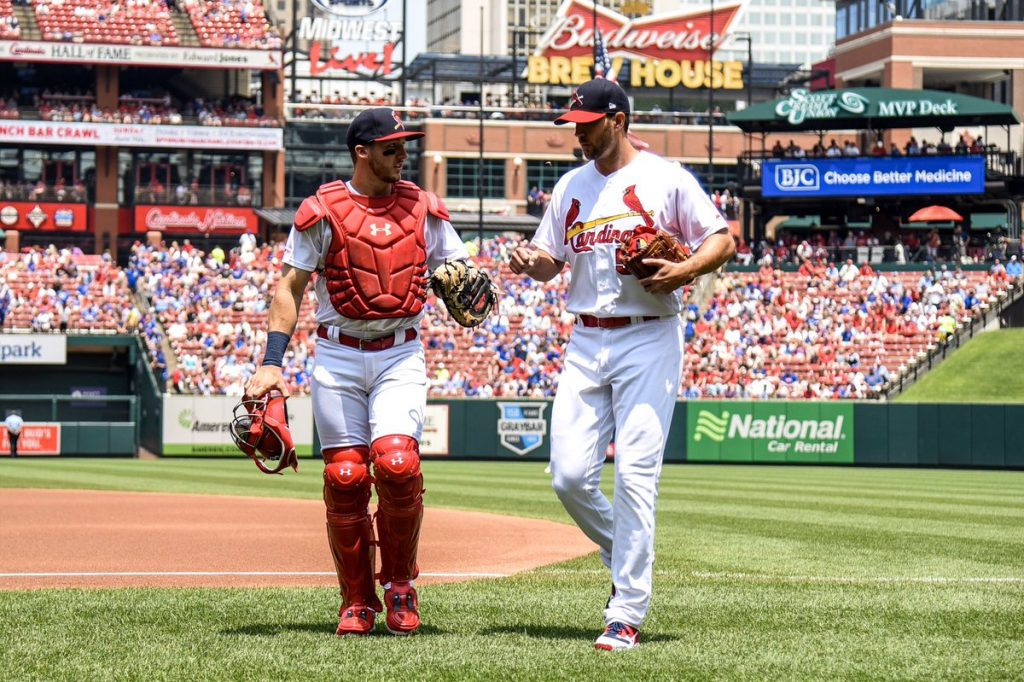 Andrew Knizner and Adam Wainwright walk back to the dugout. Knizner could be the starter in 2021 with Yadi considering free agency