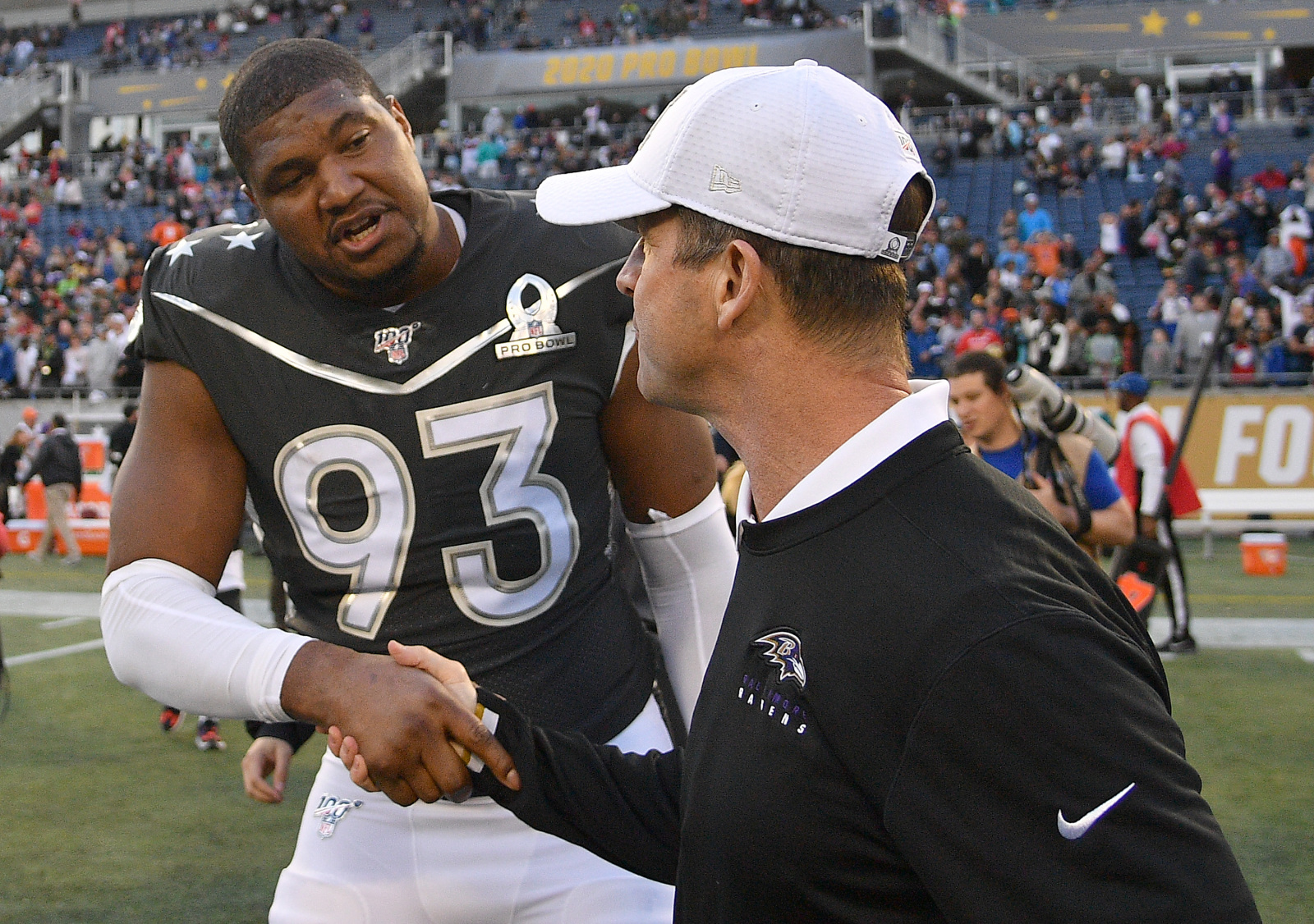 Ravens defensive linemen Calais Campbell shaking hands with John Harbaugh at Pro Bowl.