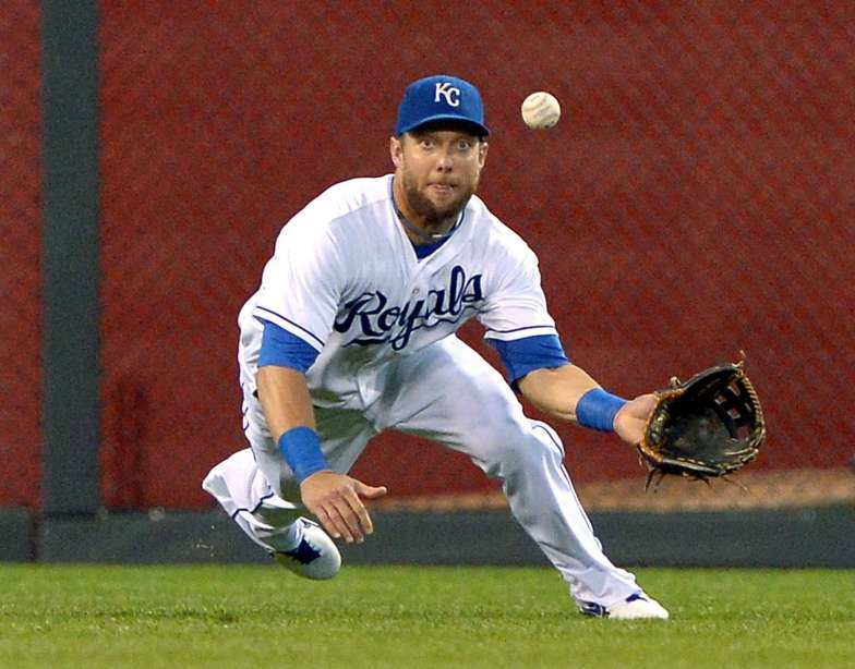 Alex Gordon diving for a ball in the outfield.