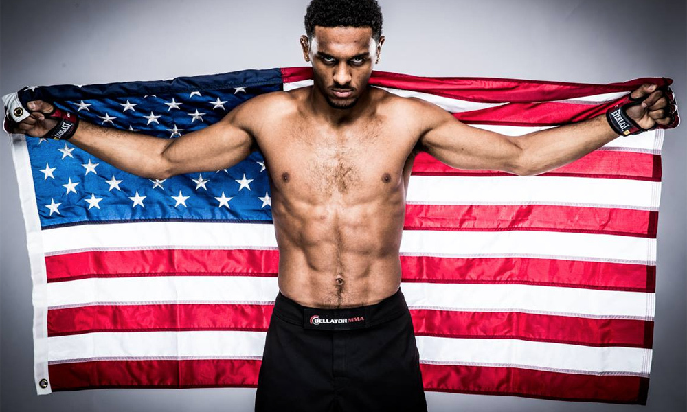 AJ McKee posing with an American Flag