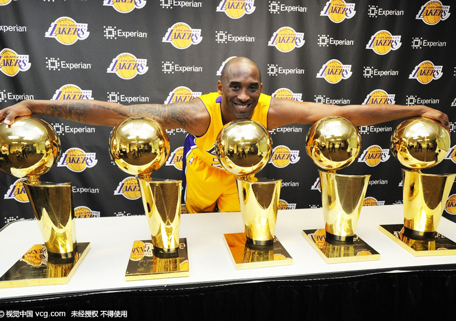 Kobe with his 5 Lakers trophies