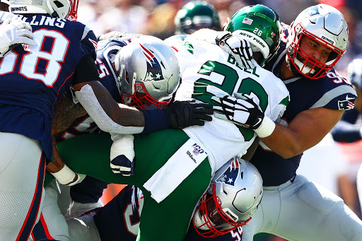 Bell, Le'Veon is smothered by the Patriots defensive line behind the line of scrimmage (Photo: Adam Glanzman/Getty Images)