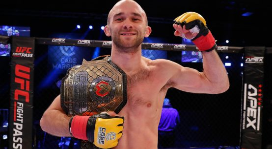 Jack Cartwright celebrates his victory at Cage Warriors 115